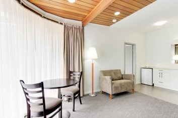 King Bedroom Lounge Accommodation in Bairnsdale - Mitchell on Main